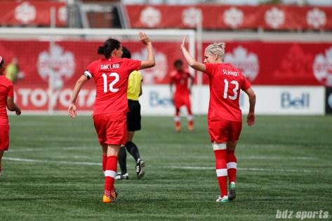 Team Canada forward Christine Sinclair (12) and Team Canada midfielder Sophie Schmidt (13)
