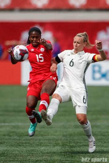 Team Canada forward Nichelle Prince (15) and Team Germany midfielder Kristin Demann (6)