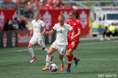 Team Germany defender Leonie Maier (4) and Team Canada forward Janine Beckie (16)