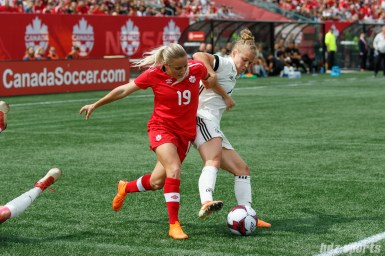 Team Canada forward Adriana Leon (19) and Team Germany defender Leonie Maier (4)