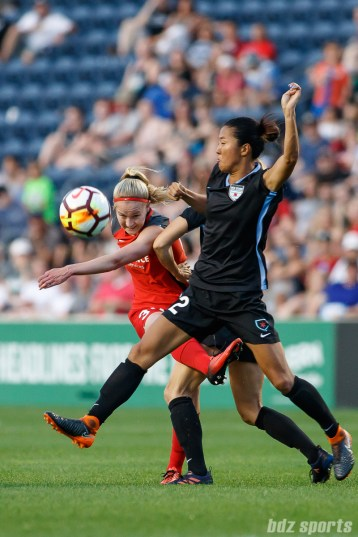 Portland Thorns forward Tyler Lussi (34) and Chicago Red Stars forward Yuki Nagasato (12)