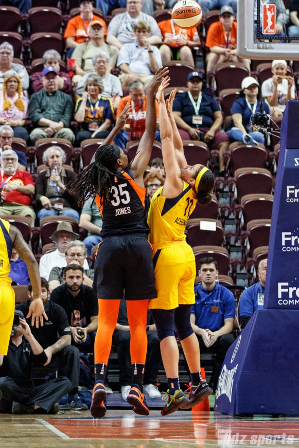 Connecticut Sun center Jonquel Jones (35) and Indiana Fever forward Natalie Achonwa (11)