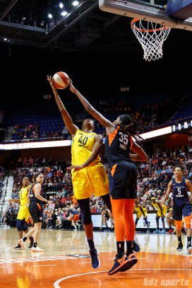 Connecticut Sun center Jonquel Jones (35) and Indiana Fever center Kayla Alexander (40)