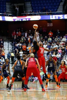 Connecticut Sun center Jonquel Jones (35) and Washington Mystics forward LaToya Sanders (30) take the opening tip off