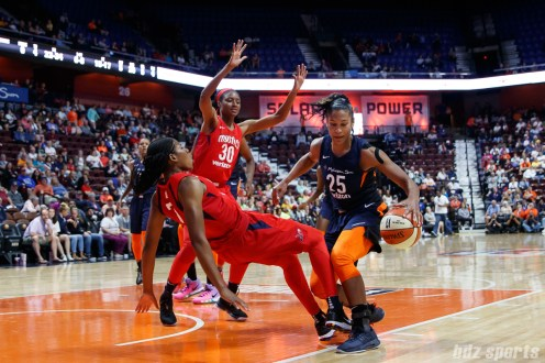 Connecticut Sun forward Alyssa Thomas (25) and Washington Mystics guard Ariel Atkins (7)