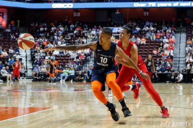 Connecticut Sun guard Courtney Williams (10) and Washington Mystics guard Natasha Cloud (9)
