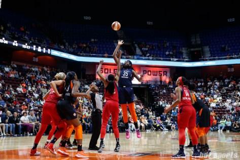 Washington Mystics forward LaToya Sanders (30) and Connecticut Sun center Jonquel Jones (35) take a jump ball