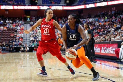 Connecticut Sun forward Shekinna Stricklen (40) and Washington Mystics guard Kristi Toliver (20)