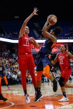 Connecticut Sun guard Jasmine Thomas (5) and Washington Mystics forward Elena Delle Donne (11)