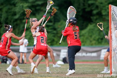 Upstate Pride midfielder Ally Carey (32) and Baltimore Brave goalie Ellie Degarmo (51)