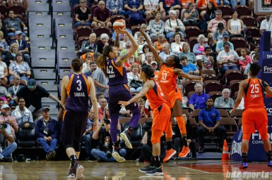 Phoenix Mercury center Brittney Griner (42) and Connecticut Sun forward Chiney Ogwumike (13)