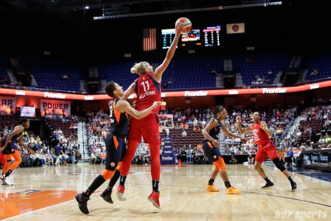 Connecticut Sun guard Layshia Clarendon (23) and Washington Mystics forward Elena Delle Donne (11)