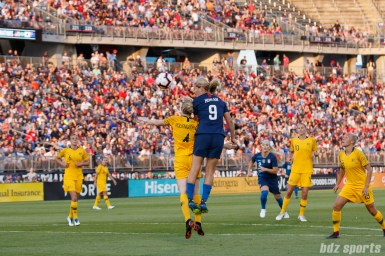 Team Australia defender Clare Polkinghorne (4) and Team USA midfielder Lindsey Horan (9)