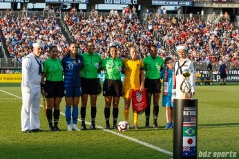 Team USA captain Alex Morgan (13) and Team Australia captain Elise Kellond-Knight (8)