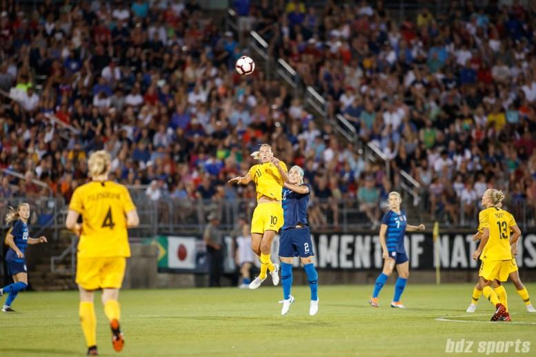 Team Australia midfielder Emily Van Egmond (10) and Team USA defender Julie Ertz (2)