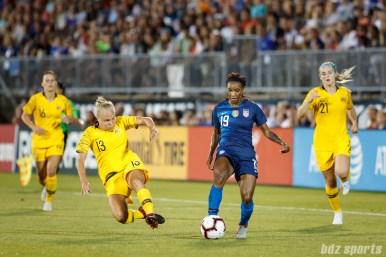 Team Australia midfielder Tameka Butt (13) and Team USA forward Crystal Dunn (19)