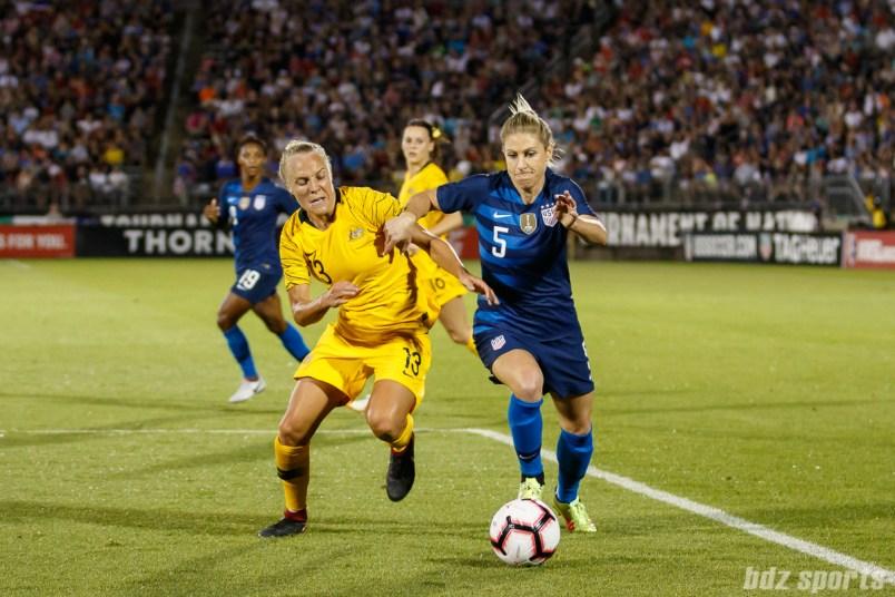 Team Australia midfielder Tameka Butt (13) and Team USA midfielder McCall Zerboni (5)