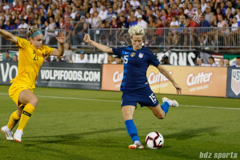 Team USA midfielder Megan Rapinoe (15) and Team Australia defender Ellie Carpenter (21)