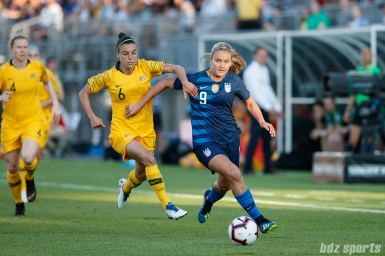 Team USA midfielder Lindsey Horan (9) and Team Australia midfielder Chloe Logarzo (6)