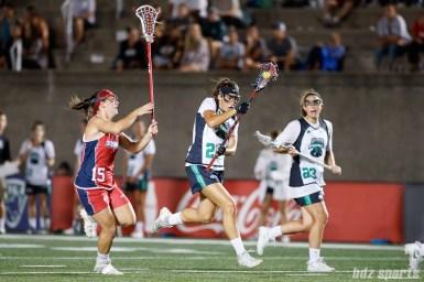 Philadelphia Force defender Carolyn Carerra (21) and Boston Storm defender Emily Boissonneault (15)