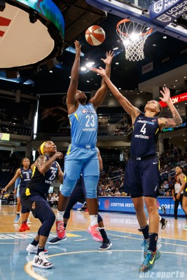 Chicago Sky guard Linnae Harper (23) and Indiana Fever forward Candice Dupree (4)