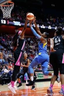 Chicago Sky forward Cheyenne Parker (32) and Connecticut Sun center Jonquel Jones (35)
