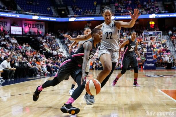 Connecticut Sun guard Courtney Williams (10) and Las Vegas Aces center A'ja Wilson (22)