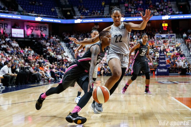 Connecticut Sun guard Courtney Williams (10) and Las Vegas Aces center A'ja Wilson (22)