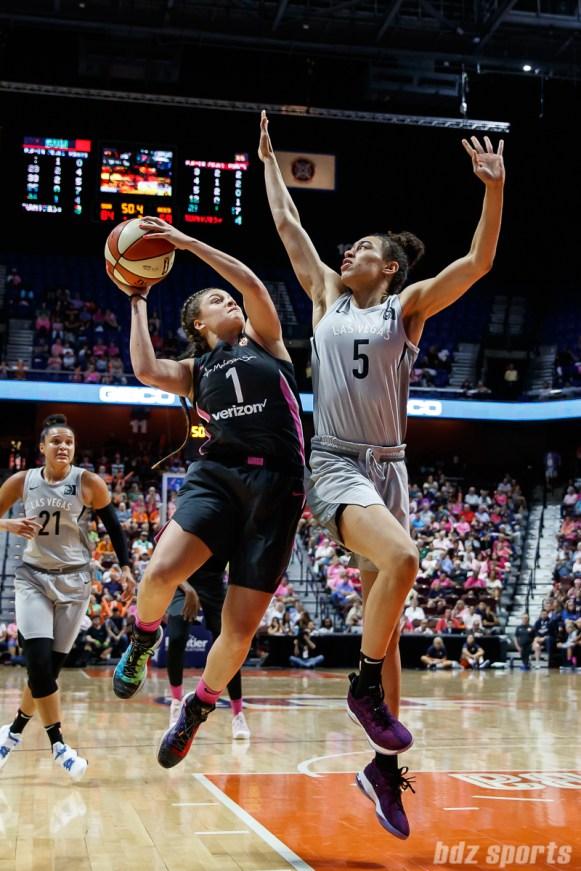 Connecticut Sun guard Rachel Banham (1) and Las Vegas Aces forward Dearica Hamby (5)