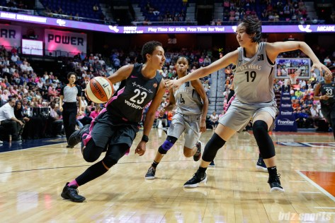 Connecticut Sun guard Layshia Clarendon (23) and Las Vegas Aces center JiSu Park (19)