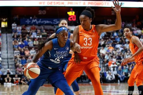 Minnesota Lynx guard Alexis Jones (12) and Connecticut Sun forward Morgan Tuck (33)
