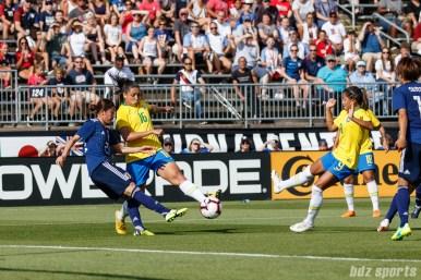 Team Japan defender Aimi Kunitake (23) and Team Brazil forward Beatriz (16)