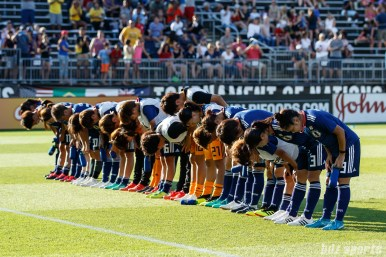 Team Japan bows to fans post-game