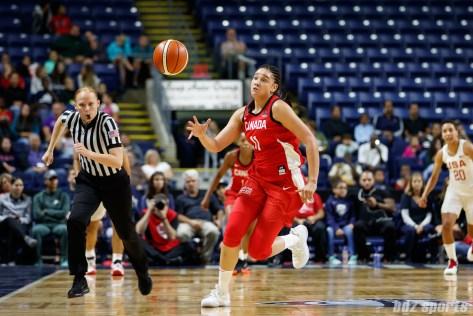 Team Canada forward Natalie Achonwa (11)