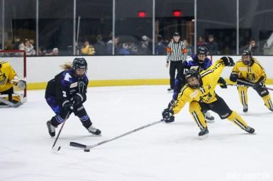 Minnesota Whitecaps forward Jonna Curtis (3) and Boston Pride defender Alyssa Gagliardi (2)