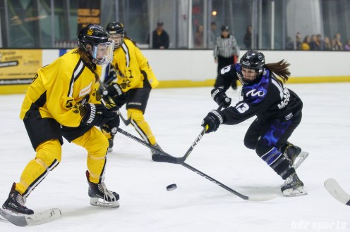 Minnesota Whitecaps forward Katie McGovern (13)