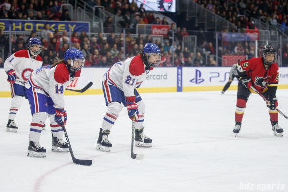 Montreal Les Canadiennes defender Erin Ambrose (14) and forward Hilary Knight (21)