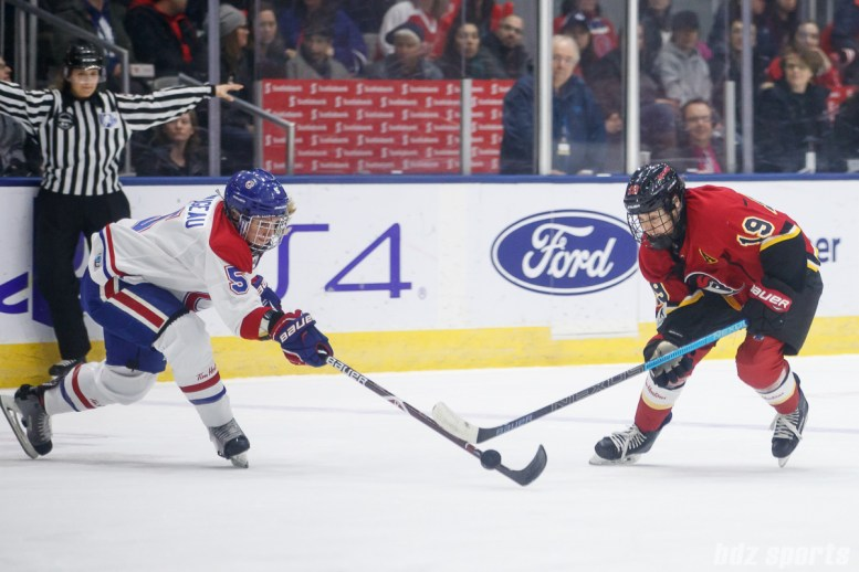 Montreal Les Canadiennes defender Lauriane Rougeau (5) and Calgary Inferno forward Brianne Jenner (19)