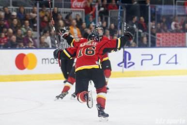 Calgary Inferno forward Rebecca Leslie (16) celebrates teammate Halli Krzyzaniak's goal