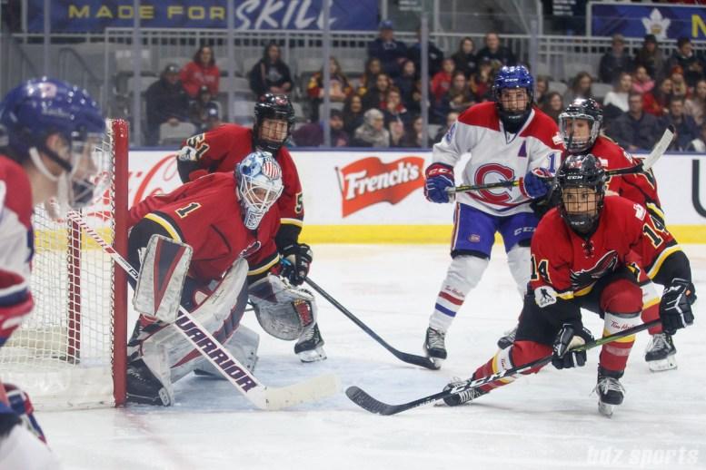 Calgary Inferno goalie Alex Rigsby (1) and forward Brianna Decker (14)