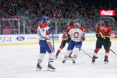 Montreal Les Canadiennes forward Ann-Sophie Bettez (24) and defender Marie-Joelle Allard (20) celebrate Bettez' goal