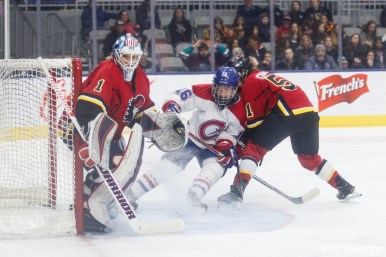 Calgary Inferno players Alex Rigsby (1) and Katelyn Gosling (51) and Montreal Les Canadiennes forward Sarah Lefort (16)