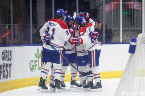 The Montreal Les Canadiennes celebrate forward Ann-Sophie Bettez's (24) second period goal