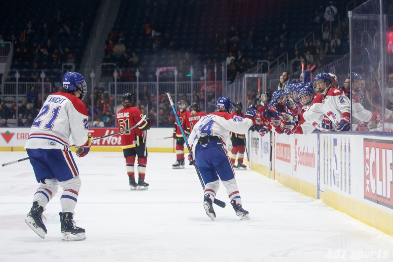 Montreal Les Canadiennes forward Ann-Sophie Bettez (24) celebrates her goal with the bench