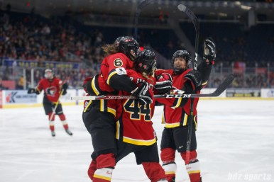 The Calgary Inferno celebrate Zoe Hickel's (44) goal