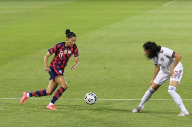 USWNT forward Christen Press (11) takes on Team Mexico defender Jimena Lopez (5) in the first of two 2021 WNT Send-Off Series games between the USWNT and Mexico at Rentschler Field in East Hartford, CT on July 1, 2021.
