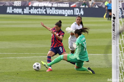 USWNT forward Christen Press (11) works her way around Team Mexico goalkeeper Itzel Gonzalez (12) in the second of two 2021 WNT Send-Off Series games between the USWNT and Mexico at Rentschler Field in East Hartford, CT on July 5, 2021.