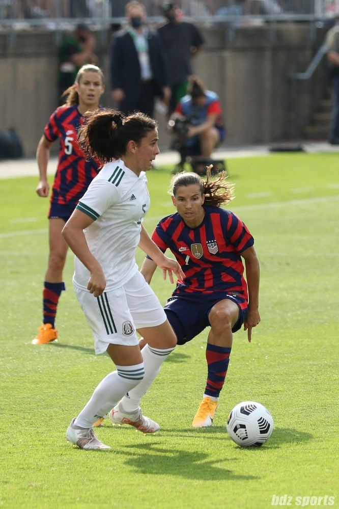 USWNT midfielder Tobin Heath (7) defnds against Team Mexico defender Jimena Lopez (5) in the second of two 2021 WNT Send-Off Series games between the USWNT and Mexico at Rentschler Field in East Hartford, CT on July 5, 2021.