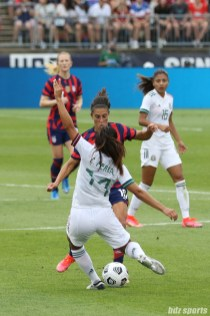 Team Mexico defender Cristina Ferral (14) attempts to clear the ball in the second of two 2021 WNT Send-Off Series games between the USWNT and Mexico at Rentschler Field in East Hartford, CT on July 5, 2021.