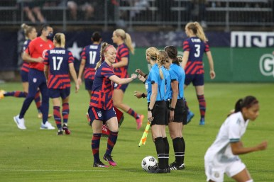 USWNT captain Becky Sauerbrunn (4) fist bumps the referees at the start of first of two 2021 WNT Send-Off Series games between the USWNT and Mexico at Rentschler Field in East Hartford, CT on July 1, 2021.